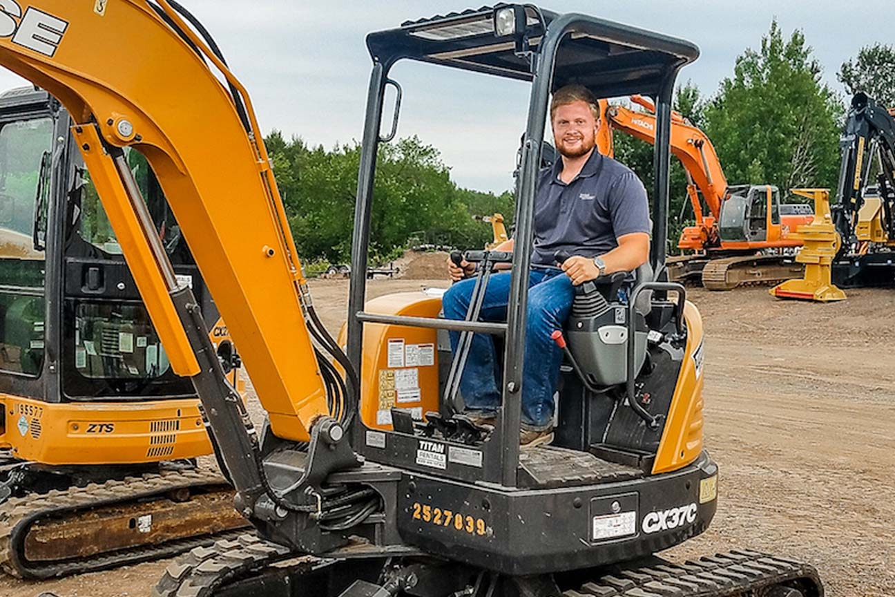 Business of Sales Intern operating a Case mini excavator