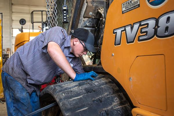 Titan diesel mechanic working on construction equipment