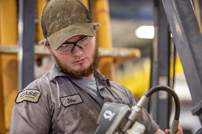 Diesel technician working on Case construction equipment