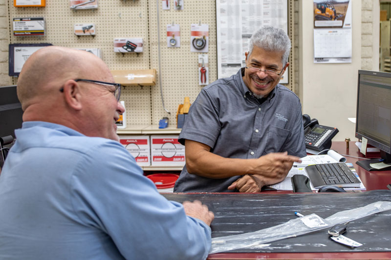 Parts Department Employee with customer