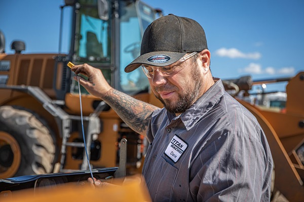 Diesel technician working with Case Construction Equipment