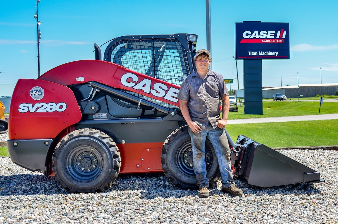 Service technician sponsorship student in front of Case SV280