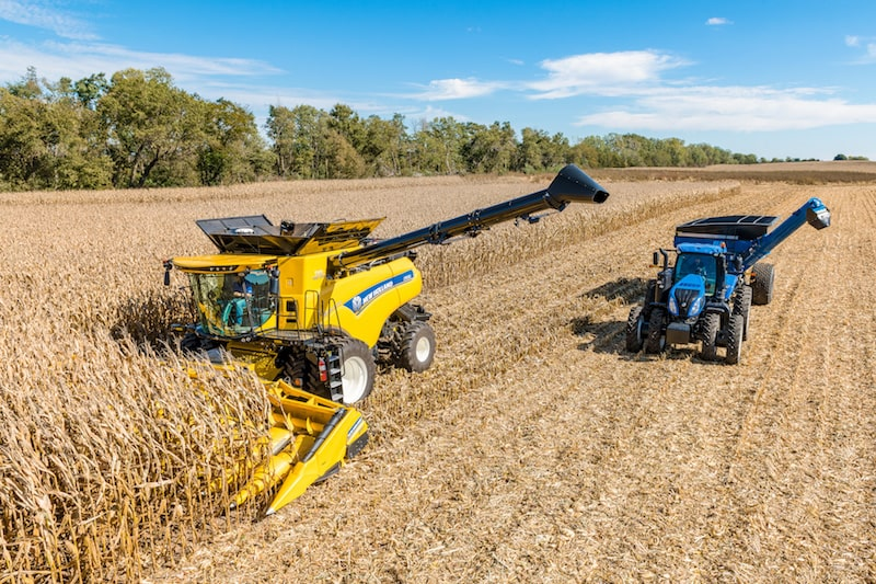 New Holland agriculture equipment harvesting corn