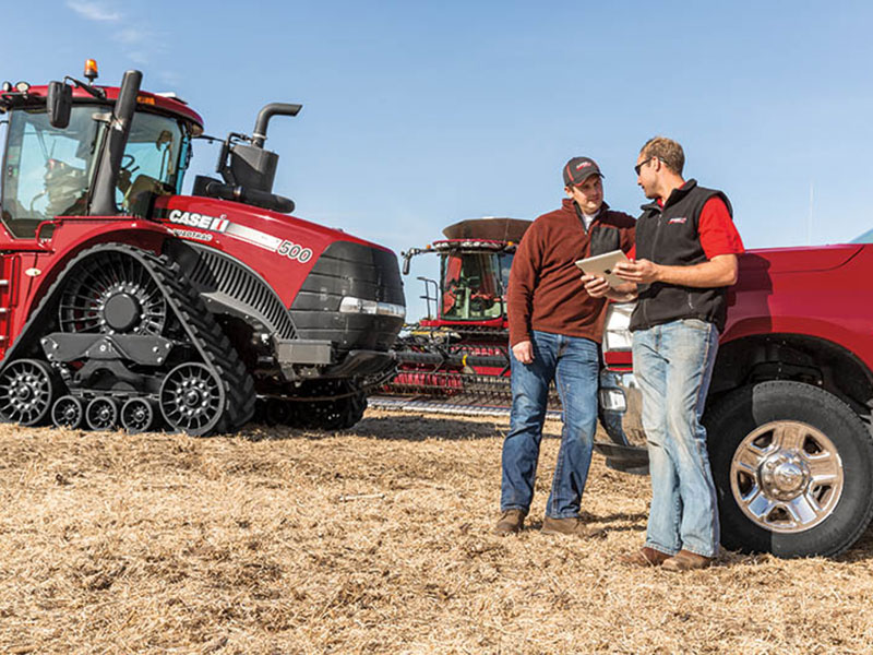 Precision Farming Specialist with customer and Case IH Quadtrac in field